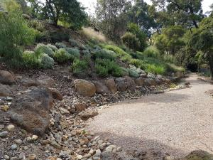 Steep garden, rocks, reatining, River stones, compacted toppings.