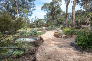Garden path, compacted toppings, compacted sandstone, Corten steel edging, Form Boss edging, Metal edging, Research garden.